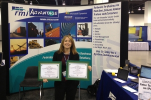 Lauren Dorman RMI's  VP-Product Development holds the certificates in RMI's booth just after they were awarded.